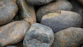 关闭环绕了灰色石渣纹理,河石头背景 免版税库存图片