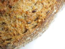 关闭生态麦子和黑麦面包与芝麻籽 免版税库存照片