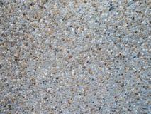 关闭由与毛面的小花岗岩石头地板决定 图库摄影