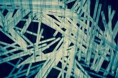 关闭白色和蓝色轻管垂悬的构成 免版税库存图片