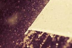 关闭的选择聚焦有雨d伞的零件 免版税库存图片