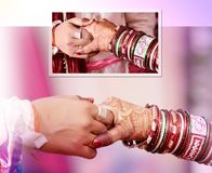 关闭相连在一个传统婚礼的新娘和新郎的手 免版税库存图片