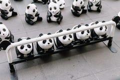关闭看法从地板的那个地方上是画展在曼谷的许多熊猫雕塑,泰国 图库摄影