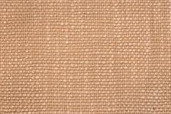 关闭米黄颜色一件毛织物品  免版税库存图片