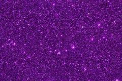 关闭紫色紫罗兰色闪烁纹理, feative发光的backg 库存照片