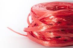 关闭红色塑料在白色背景的绳索顶视图 图库摄影
