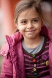 关闭美丽的微笑的小女孩 图库摄影
