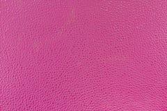 关闭背景现实桃红色高quility皮革纹理 库存图片