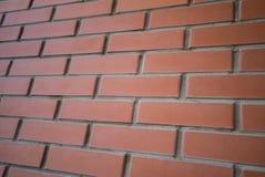 关闭背景都市红砖墙壁的 图库摄影