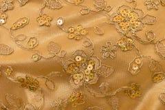 关闭菩萨的手工制造衣服饰物之小金属片布料 库存照片