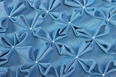 关闭蓝色纺织品吹背景  免版税库存图片