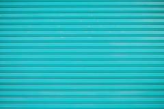 关闭蓝色金属板幻灯片门纹理背景 免版税库存图片