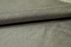 关闭衬衣卷条纹灰色和黑织品  免版税库存图片