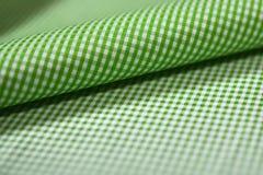 关闭衬衣卷绿色和白色斯科特样式织品  库存图片