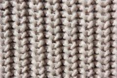 关闭被编织的米黄羊毛细节  图库摄影