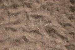 关闭视图海滩沙子背景 织地不很细 库存照片