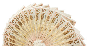 关闭许多50张欧洲钞票被扇动对半圈 免版税库存图片