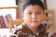 关闭逗人喜爱的亚裔男孩画象  图库摄影