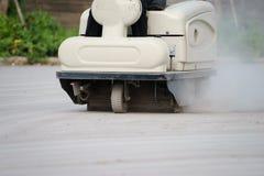 关闭道路清扫工擦净剂射击  库存图片