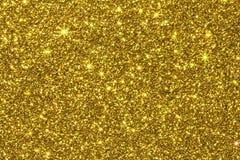 关闭魅力背景的金黄闪烁纹理 库存图片