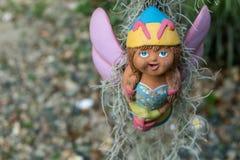 关闭,庭院装饰的,精选的焦点面孔愉快的玩偶 库存图片