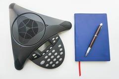 关闭voip IP有笔记本和镜片的会议电话见面的 免版税图库摄影