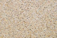 关闭wal石渣墙壁样式水泥被混合的小石渣的石头 免版税库存照片