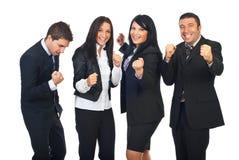 兴奋人员合作与在商业的成功 库存照片