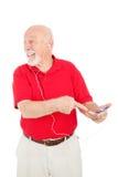 兴奋人MP3播放器前辈 库存图片