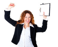 兴奋女商人享受一个成功的交易 免版税库存图片