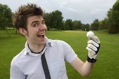兴奋高尔夫球人年轻人 库存照片