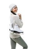 兴高采烈的妇女形象溜冰者拿着冰鞋 库存图片