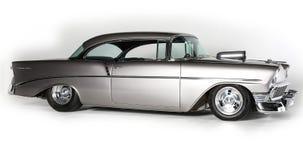 经典之作1956年薛佛列在白色背景的突然行动汽车,被隔绝 66查出的途径s符号u葡萄酒白色 S 汽车 库存照片