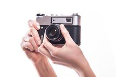 经典之作35mm照片照相机在手中 免版税库存照片