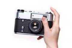 经典之作35mm照片照相机在手中 免版税库存图片