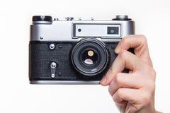 经典之作35mm照片照相机在手中 免版税图库摄影