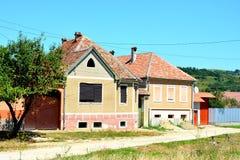 典型的房子在村庄Merghindeal- Mergenthal,特兰西瓦尼亚,罗马尼亚 库存照片