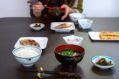 典型的日本午餐膳食在有鱼、汤和米的山形县 库存图片
