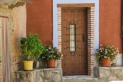 典型的村庄房子门面  库存图片