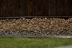 典型的欧洲堆木材的棚在阿尔卑斯 图库摄影