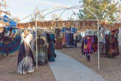 典型的衣裳在风滚草节日期间的待售 图库摄影