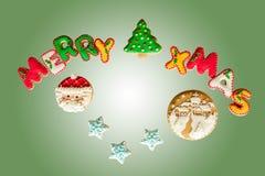 经典自创姜饼圣诞快乐曲奇饼 免版税图库摄影