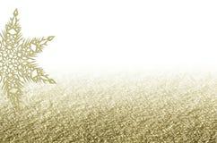 典雅的与雪花的圣诞节金黄背景 图库摄影