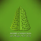 典雅的圣诞树(裁减纸)在绿色背景 库存图片