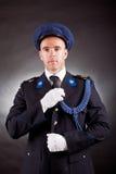典雅的战士佩带的制服 免版税库存照片