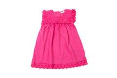 典雅的浅粉红色的儿童夏天礼服,被隔绝 免版税库存图片