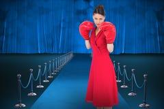 典雅的浅黑肤色的男人的综合图象红色礼服佩带的拳击手套的 免版税图库摄影