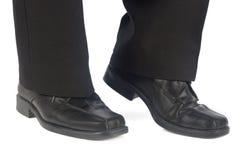 典雅的男穿上鞋子长裤 图库摄影