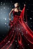 典雅的红色礼服的妇女。 专业人员mak 免版税库存图片