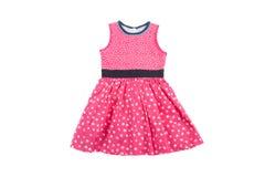 典雅的轻的儿童夏天dresse 在白色小点的桃红色 免版税库存照片
